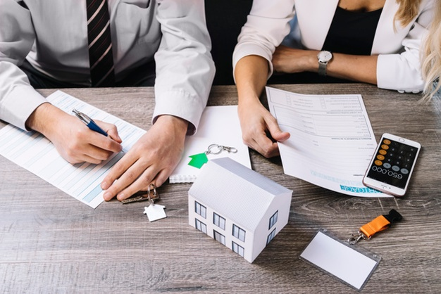 landlord insurance experts filling out paperwork
