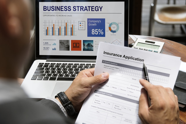 a startup founder examining a business insurance application